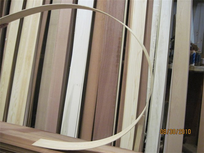 """.200""""+/- Veneers are bendable, as shown and many clients use them to glue up for radius heads. The veneers used as a backdrop only display a small amount of the variety of woods we offer."""